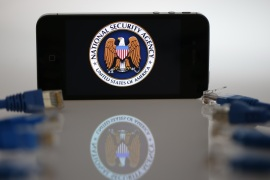 An illustration picture shows the logo of the U.S. National Security Agency on the display of an iPhone in Berlin, June 7, 2013. The debate over whether the U.S. government is violating citizens' privacy rights while trying to protect them from terrorism escalated dramatically on Thursday amid reports that authorities have collected data on millions of phone users and tapped into servers at nine internet companies.   REUTERS/Pawel Kopczynski   (GERMANY – Tags: POLITICS