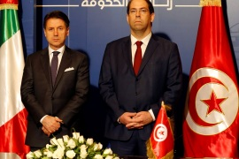 Tunisian Prime Minister Youssef Chahed stands next to his Italian counterpart Giuseppe Conte during an agreements signing ceremony, in Tunis, Tunisia, April 30, 2019. REUTERS/Zoubeir Souissi