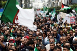 Demonstrators hold flags and banners as they return to the streets to press demands for wholesale democratic change well beyond former president Abdelaziz Bouteflika's resignation, in Algiers, Algeria April 19, 2019.   REUTERS/Ramzi Boudina
