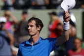 Mar 25, 2014; Miami, FL, USA; Andy Murray waves to the crowd after his match against Jo-Wilfried Tsonga (not pictured) on day nine of the Sony Open at Crandon Tennis Center. Murray won 6-4, 6-1. Mandatory Credit: Geoff Burke-USA TODAY Sports