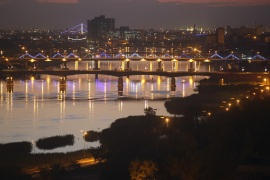 BAGHDAD, IRAQ – APRIL 13: Bridges span the Tigris River into the high-security Green Zone (L), on April 13, 2015 in Baghdad, Iraq. Baghdad has again come to life at night following the February lifting of the 12-year old evening curfew. Despite the continued risk of terror attacks and an escalating military offensive with ISIS extremists not far from the capitol, Baghdadis have taken to the nocturnal streets throughout the city. (Photo by John Moore/Getty Images)