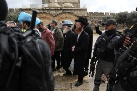 Israeli police secure a group of visitors, some of them wearing Jewish skullcaps, as they tour the compound known to Jews as Temple Mount and to Muslims as The Noble Sanctuary, in Jerusalem's Old City March 14, 2019. REUTERS/Ammar Awad
