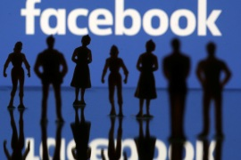 Small toy figures are seen in front of Facebook logo in this illustration picture, April 8, 2019. REUTERS/Dado Ruvic/Illustration