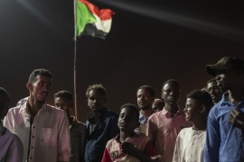 KHARTOUM, SUDAN – APRIL 27: Protestors stand in the street outside the Ministry of Defence during evening protests against the military junta on April 27, 2019 in Khartoum, Sudan. After months of protesting from the people of Sudan, organised by the Sudanese Professionals' Association (SPA), President Omar al-Bashir was ousted having been in power since 1989. The following day they also forced his successor, Awad Ibn Auf, to step down. The SPA and the people have organised a sit in at the Ministry of Defence calling for the