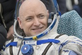 ZHEZKAZGAN, KAZAKHSTAN – MARCH 2: In this handout provided by NASA, Expedition 46 Commander Scott Kelly of NASA rest in a chair outside of the Soyuz TMA-18M spacecraft just minutes after he and Russian cosmonauts Mikhail Kornienko and Sergey Volkov of Roscosmos landed in a remote area on March 2, 2016 near the town of Zhezkazgan, Kazakhstan. Kelly and Kornienko completed an International Space Station record year-long mission to collect valuable data on the effect of long duration weightlessness on the human body that will be used to formulate a human mission to Mars. Volkov returned after spending six months on the station. (Photo by Bill Ingalls/NASA via Getty Images)