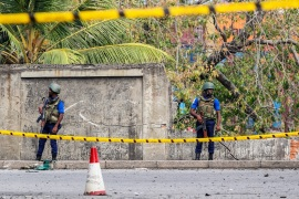 Aftermath of multiple terror attacks in Sri Lanka- – COLOMBO – SRI LANKA – APRIL 24 : Security personnel stand guard near the debris of a vehicle after a controlled blasting near Colombo Fort in Colombo on April 24, 2019.
