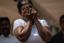 NEGOMBO, SRI LANKA – APRIL 24: A woman is overcome with emotion as she attends the funeral of a person killed in the Easter Sunday attack on St Sebastian's Church, on April 24, 2019 in Negombo, Sri Lanka. At least 321 people were killed and 500 people injured after coordinated attacks on churches and hotels on Easter Sunday in and around Colombo as well as at Batticaloa in Sri Lanka. According to reports, the Islamic State group have claimed responsibility on Tuesday for the attacks while investigations show the attacks were carried out in retaliation for the Christchurch mosque shootings last month. Police have detained 40 suspects so far in connection with the suicide bombs while the government blame the attacks on local Islamist group National Thowheed Jamath (NTJ). (Photo by Carl Court/Getty Images)