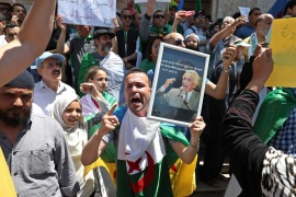 epa07560408 Algerians protest during a demonstration for the departure of the Algerian regime in Algiers, Algeria, 10 May 2019. Media reports state that the protesters are demanding the departure of the Algerian government. EPA-EFE/MOHAMED MESSARA