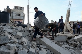 Israeli attacks on Gaza- – RAFAH, GAZA – MAY 5 : Palestinians recover materials, which are still usable, from the debris of a totally collapsed building after Israeli army carried out airstrikes in Rafah, Gaza on May 5, 2019.