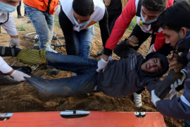 A wounded Palestinian is evacuated during a protest near the Israel-Gaza border fence in the southern Gaza Strip December 21 2018. REUTERS.png