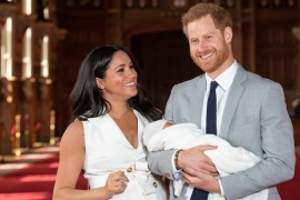 WINDSOR, ENGLAND – MAY 08: Prince Harry, Duke of Sussex and Meghan, Duchess of Sussex, pose with their newborn son Archie Harrison Mountbatten-Windsor during a photocall in St George's Hall at Windsor Castle on May 8, 2019 in Windsor, England. The Duchess of Sussex gave birth at 05:26 on Monday 06 May, 2019. (Photo by Dominic Lipinski – WPA Pool/Getty Images)
