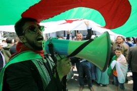 A demonstrator uses a bullhorn to shout protest slogans during a May Day march on Labour Day in Algiers, Algeria, May 1, 2019.  REUTERS/Ramzi Boudina
