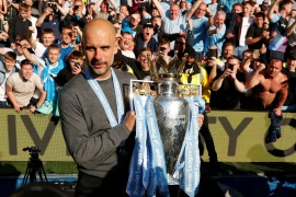 Soccer Football – Premier League – Brighton & Hove Albion v Manchester City – The American Express Community Stadium, Brighton, Britain – May 12, 2019  Manchester City manager Pep Guardiola poses with the trophy as he celebrates winning the Premier League           Action Images via Reuters/John Sibley  EDITORIAL USE ONLY. No use with unauthorized audio, video, data, fixture lists, club/league logos or
