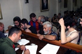 Syrian prisoners sign release papers at the Damascus Police Command headquarters in 2012.CreditBassem Tellawi/Associated Press
