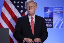BRUSSELS, BELGIUM – JULY 12:  U.S. National Security Advisor John Bolton listens as U.S. President Donald Trump (not pictured) speaks to the media at a press conference on the second day of the 2018 NATO Summit on July 12, 2018 in Brussels, Belgium. Leaders from NATO member and partner states are meeting for a two-day summit, which is being overshadowed by strong demands by U.S. President Trump for most NATO member countries to spend more on defense.  (Photo by Sean Gal