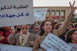 Protest on 'violence against women' in Rabat- – RABAT, MOROCCO – MARCH 08: Women hold banners during a protest on 'violence against women' regarding the International Women's Day in front of Parliament Building in Rabat, Morocco on March 08, 2018.