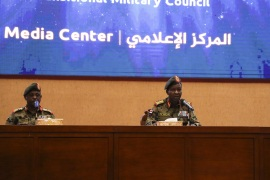 Sudan's ruling Military Council spokesperson Shamseddine Kabbashi- – KHARTOUM, SUDAN – MAY 08: Sudan's ruling Military Council spokesperson Shamseddine Kabbashi (C) makes a speech as he holds a press conference at the Presidential Palace in Khartoum, Sudan on May 08, 2019.