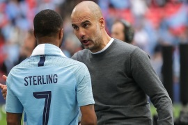 LONDON, ENGLAND – MAY 18: Josep Guardiola, Manager of Manchester City speaks to Raheem Sterling of Manchester City after they won the FA Cup Final match between Manchester City and Watford at Wembley Stadium on May 18, 2019 in London, England.  (Photo by Richard Heathcote/Getty Images)