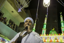 epa07547770 A man sings Islamic songs during celebrations two days ahead of the holy month of Ramadan at al-Baragel, Cairo, Egypt, 04 May 2019. Muslims around the world celebrate the holy month of Ramadan by praying during the night time and abstaining from eating, drinking, and sexual acts daily between sunrise and sunset. Ramadan is the ninth month in the Islamic calendar and it is believed that the Koran's first verse was revealed during its last 10 nights. EPA-EFE/MOHAMED HOSSAM