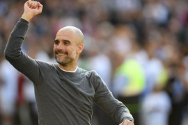 BRIGHTON, ENGLAND – MAY 12: Manchester City manager Pep Guardiola salutes the Manchester City fans after the Premier League match between Brighton & Hove Albion and Manchester City at American Express Community Stadium on May 12, 2019 in Brighton, United Kingdom. (Photo by Mike Hewitt/Getty Images)