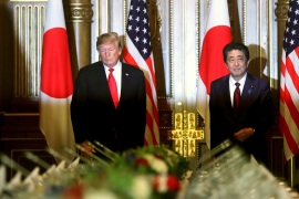 U.S. President Donald Trump and Japan's Prime Minister Shinzo Abe walk to take their seats before their working lunch in Tokyo, Japan May 27, 2019. REUTERS/Jonathan Ernst