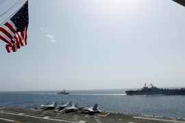 The U.S. Navy Wasp-class amphibious assault ship USS Kearsarge and the Arleigh Burke-class guided-missile destroyer USS Bainbridge sail alongside the Nimitz-class aircraft carrier USS Abraham Lincoln in the Arabian Sea May 17, 2019. Picture taken May 17, 2019. US Navy/Mass Communication Specialist Seaman Michael Singley/Handout via REUTERS. ATTENTION EDITORS – THIS IMAGE WAS PROVIDED BY A THIRD PARTY.