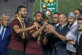 Esperance v Wydad Casablanca: CAF Champions league- – RADES, TUNIS – JUNE 1: Football players of Esperance receive trophy from Tunisian Prime Minister Youssef Chahed as Esperance won the championship title after football players of Wydad Casablanca abandoned the field during the CAF (Confederation of African Football) Champions league final match between Esperance and Wydad Casablanca at Stade Olympique de Rades in Rades, Tunisia on June 1, 2019.