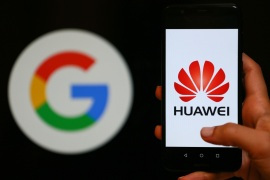 Huawei logo- – IZMIR, TURKEY – MAY 28: A person holds a Huawei mobile phone in front of logo of Google in Izmir, Turkey on May 28, 2019.