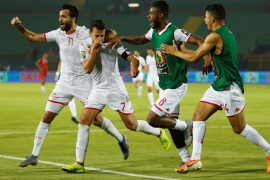 Soccer Football – Africa Cup of Nations 2019 – Quarter Final – Madagascar v Tunisia – Al Salam Stadium, Cairo, Egypt – July 11, 2019  Tunisia's Youssef Msakni celebrates scoring their second goal with team mates               REUTERS/Amr Abdallah Dalsh