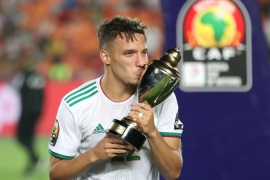 Soccer Football – Africa Cup of Nations 2019 – Final – Senegal v Algeria – Cairo International Stadium, Cairo, Egypt – July 19, 2019    Algeria's Ismael Bennacer celebrates winning the Best Young Player of the Tournament with the trophy   REUTERS/Suhaib Salem