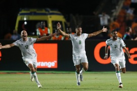 Soccer Football – Africa Cup of Nations 2019 – Semi Final – Algeria v Nigeria – Cairo International Stadium, Cairo, Egypt – July 14, 2019  Algeria's Riyad Mahrez celebrates scoring their second goal with Adlene Guedioura and Youcef Belaili   REUTERS/Amr Abdallah Dalsh
