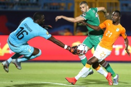 Soccer Football – Africa Cup of Nations 2019 – Quarter Final – Ivory Coast v Algeria – Suez Stadium, Suez, Egypt – July 11, 2019  Ivory Coast's Sylvain Gbohouo saves a shot from Algeria's Islam Slimani               REUTERS/Suhaib Salem