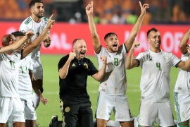 Soccer Football – Africa Cup of Nations 2019 – Final – Senegal v Algeria – Cairo International Stadium, Cairo, Egypt – July 19, 2019    Algeria's Riyad Mahrez, coach Djamel Belmadi and team mates celebrate in front of their fans after winning the Africa Cup of Nations   REUTERS/Suhaib Salem