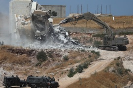 Israeli military machinery demolishes a Palestinian building in the village of Sur Baher which sits on either side of the Israeli barrier in East Jerusalem and the Israeli-occupied West Bank July 22, 2019. REUTERS/Ammar Awad