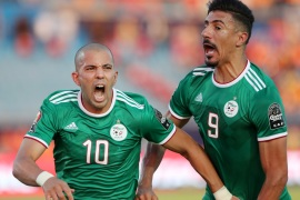 Soccer Football – Africa Cup of Nations 2019 – Quarter Final – Ivory Coast v Algeria – Suez Stadium, Suez, Egypt – July 11, 2019  Algeria's Sofiane Feghouli celebrates scoring their first goal with Baghdad Bounedjah       REUTERS/Suhaib Salem
