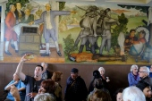 "People fill the main entryway of George Washington High School to view the controversial 13-panel, 1,600-square foot mural, the ""Life of Washington,"" in San Francisco. (Eric Risberg)"