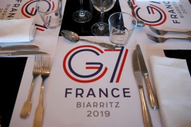 G7 summit in Biarritz A G7 table set is pictured in the press center during the G7 summit in Biarritz, France, August 24, 2019. REUTERS/Christian Hartmann