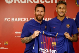 FC Barcelona players Lionel Messi (L) and Neymar holding their uniforms pose for a photo during a news conference to announce the sponsorship deal between the team and Japanese e-commerce operator Rakuten Inc. in Tokyo, Japan July 13, 2017.  REUTERS/Kim Kyung-Hoon