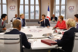BIARRITZ, FRANCE – AUGUST 25: Canada's Prime Minister Justin Trudeau, Britain's Prime Minister Boris Johnson, Germany's Chancellor Angela Merkel, European Council President Donald Tusk, France's President Emmanuel Macron, Japan's Prime Minister Shinzo Abe and US President Donald Trump meet for the first working session of the G7 Summit on August 25, 2019 in Biarritz, France. The French southwestern seaside resort of Biarritz is hosting the 45th G7 summit from August 24 to 26. High on the agenda will be the climate emergency, the US-China trade war, Britain's departure from the EU, and emergency talks on the Amazon wildfire crisis. (Photo by Jeff J Mitchell – Pool /Getty Images)