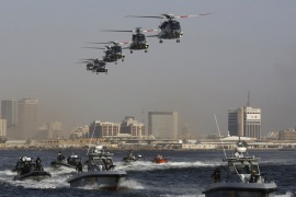 Helicopters and boats are seen during a military drill by members of the Saudi Security forces, in Jeddah City May 27, 2014.  REUTERS/Mohamed Alhwaity (SAUDI ARABIA – Tags: MILITARY)