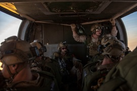 Marines assigned to Maritime Raid Force, 11th Marine Expeditionary Unit (MEU) prepare to jump out of a UH-60 Black Hawk at Camp Buehring, Kuwait City, Kuwait, in this undated  handout picture released by U.S. Navy on August 4, 2019. Jared Sabins/U.S. Army/Handout via REUTERS ATTENTION EDITORS- THIS IMAGE HAS BEEN SUPPLIED BY A THIRD PARTY.