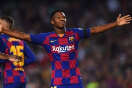 BARCELONA, SPAIN – SEPTEMBER 14:   Anssumane Fati of Barcelona celebrates after scoring his team's first goal during the Liga match between FC Barcelona and Valencia CF at Camp Nou on September 14, 2019 in Barcelona, Spain. (Photo by Alex Caparros/Getty Images)
