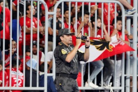 Soccer Football – African Champions League Final – First Leg – Al Ahly vs Esperance Sportive de Tunis – Borg El Arab Stadium, Alexandria, Egypt – November 2, 2018  A police officer with a camera inside the stadium before the match   REUTERS/Amr Abdallah Dalsh