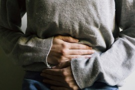 الامساك constipation – Woman suffering from stomach ache