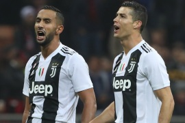 MILAN, ITALY – NOVEMBER 11:  (L-R) Medhi Benatia and Cristiano Ronaldo of Juventus FC celebrate a victory at the end of the Serie A match between AC Milan and Juventus at Stadio Giuseppe Meazza on November 11, 2018 in Milan, Italy.  (Photo by Marco Luzzani/Getty Images)