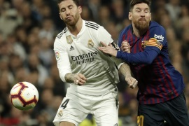 Real Madrid vs Barcelona: La Liga- – MADRID, SPAIN – MARCH 02: Lionel Messi (R) of Barcelona in action against Sergio Ramos (L) of Real Madrid during the La Liga week 26 soccer match between Real Madrid and Barcelona at Santiago Bernabeu Stadium in Madrid, Spain on March 02, 2019.