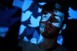 LONDON, ENGLAND – AUGUST 09:  In this photo illustration, the logo for the Twitter social media network is projected onto a man on August 09, 2017 in London, England. With around 328 million users worldwide, Twitter has gone from a small start-up in for the public 2006 to a broadcast tool of politicians and corporations in 2017.  (Photo by Leon Neal/Getty Images)