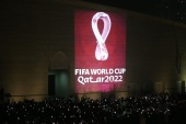 Qatar reveals 2022 World Cup logo- – DOHA, QATAR – SEPTEMBER 03: Hundreds of people take a photo as the official logo of the 'FIFA World Cup Qatar 2022' is reflected on a wall of the Amphitheatre in Doha, Qatar on September 03, 2019.