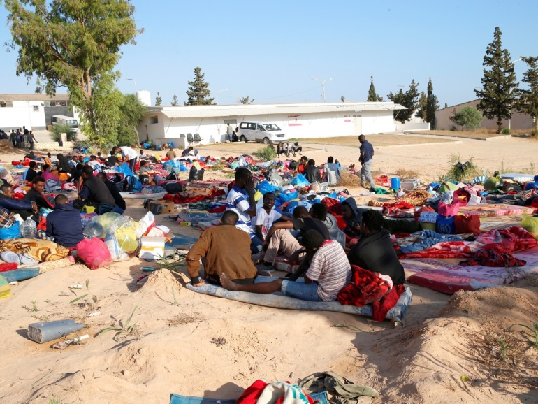 Migrants are seen with their belongings at a detention centre for mainly African migrants that was hit by an airstrike, in the Tajoura suburb of Tripoli, Libya July 3, 2019. REUTERS/Ismail Zitouny
