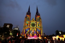 "SYDNEY, AUSTRALIA – DECEMBER 06: Projections are displayed on the facade of St Mary's Cathedral during the 'Lights of Christmas"" celebration of Christmas on December 06, 2019 in Sydney, Australia. (Photo by Cameron Spencer/Getty Images)"
